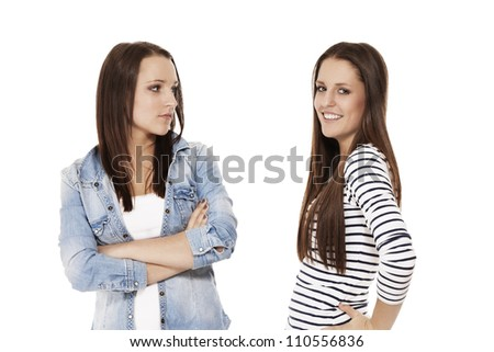 one happy and one upset teenager on white background - stock photo