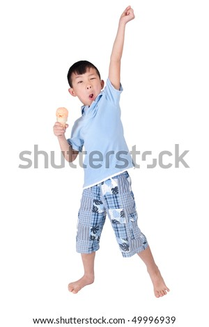 one happy asian young boy celebrating and eating ice cream isolated on white - stock photo