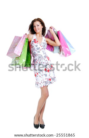 one happy young beautiful girl with the bags - on white