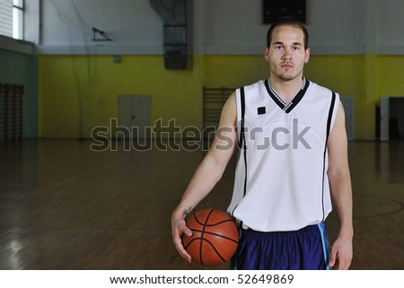 one healthy young  man play basketball game in school gym indoor relax - stock photo