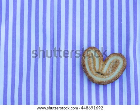 one heart cookies on the purple napkin - stock photo