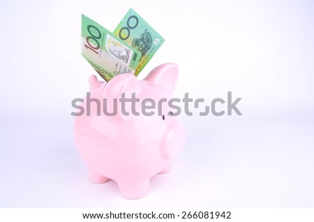 One hundred Australian dollar note and a pink piggy bank - stock photo