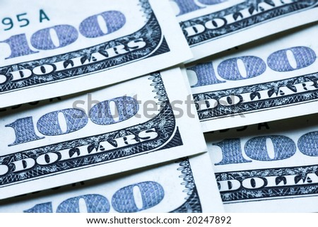 One hundred dollar banknotes crop - stock photo
