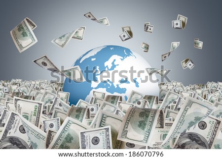 One hundred dollar banknotes flying and falling on money farm and around earth globe, dark background. - stock photo