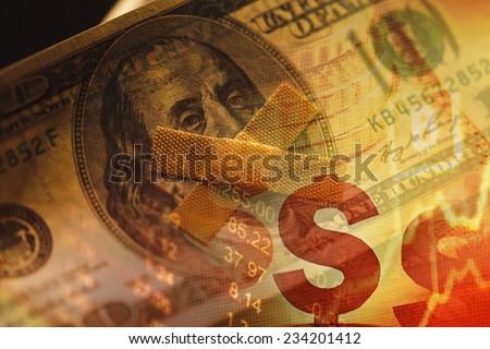 One hundred dollar bill and plaster. US dollar debt. - stock photo