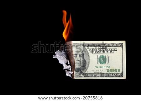 One hundred dollar bill burning - stock photo