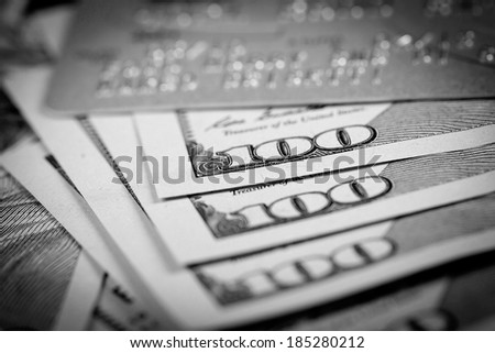 One Hundred Dollars and Credit Card - stock photo