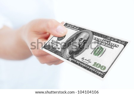 one hundred dollars banknote holded by hand over white background.focus on banknote
