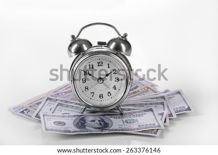One hundred dollars banknotes and alarm isolated - stock photo