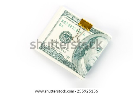 One hundred dollars banknotes in money clip isolated - stock photo