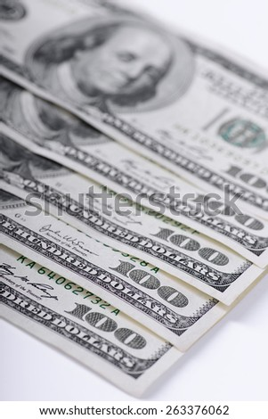 One hundred dollars banknotes on light background - stock photo