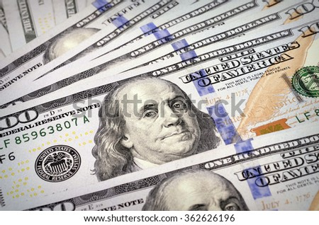 One hundred dollars /new 100 US dollar 2013 edition banknotes/ pile as background with selective focus effect - stock photo