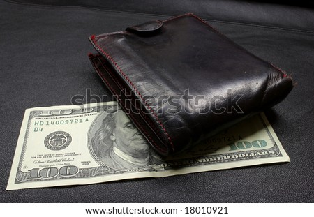 one hundred dollars on a dark background