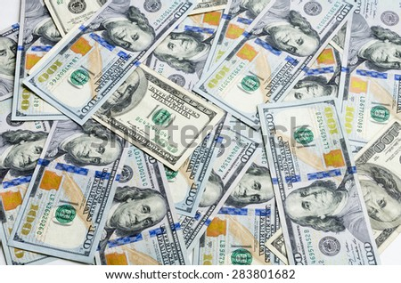 One hundred dollars pile (dollars banknote ) old and new as background. - stock photo