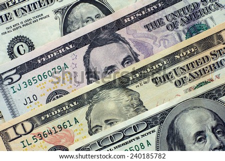 One hundred dollars, ten dollars, five dollars and one dollar. Closeup. - stock photo