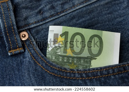 One hundred euro banknote in the jeans pocket - stock photo