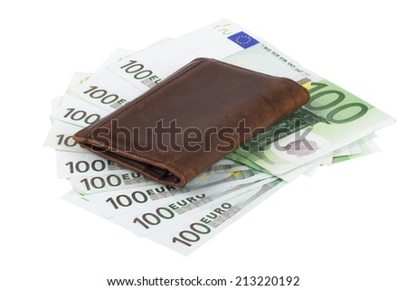 One hundred euro banknotes and brown business wallet, isolated on white background. - stock photo