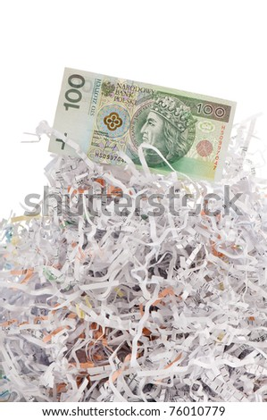 One hundred polish zloty banknote on paper shreds pile on white background in vertical orientation, nobody. - stock photo