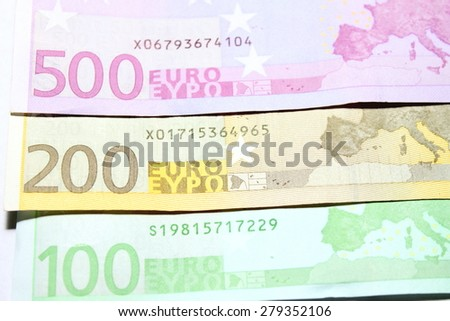 One hundred, two hundred and five hundred euro bills close-up. Shallow focus. - stock photo