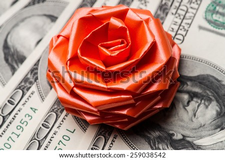 One hundred US dollars bills with holidays bow. - stock photo