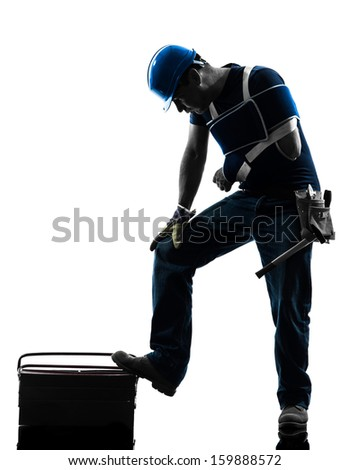 one injured manual worker man with injury brace in silhouette on white background - stock photo