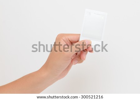 One instant photo in hand isolated on white background - stock photo