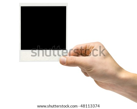 One instant photo in hand isolated on white background