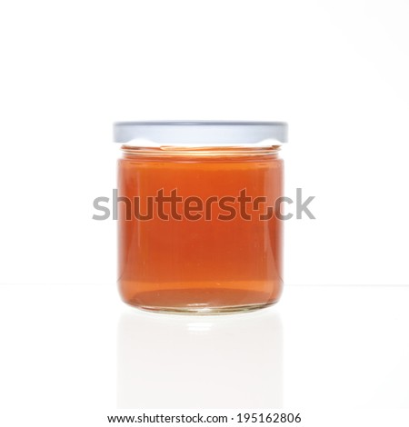 One jelly jar with no label against a white background and a slight reflection. - stock photo