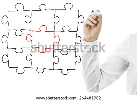 One jigsaw piece stands out - stock photo