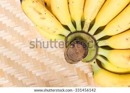 One kind of banana is ripe dainty banana on threshing basket a traditional style - stock photo