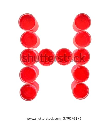 One letter of the alphabet. red drink in a glass - stock photo