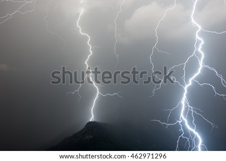 One lightning in the background with one massive lightning in the foreground