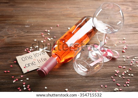 One love, one life concept - wine bottle and glasses with hearts around, close up - stock photo