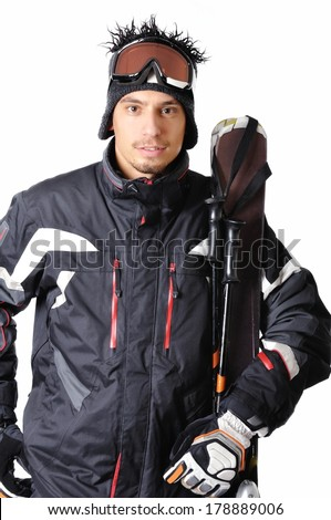 One male skier posing on a white background