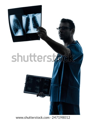 one  man doctor surgeon radiologist medical examining lung torso x-ray image silhouette isolated on white background - stock photo