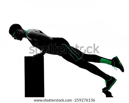 one man exercising fitness crossfit  in silhouette isolated on white background - stock photo