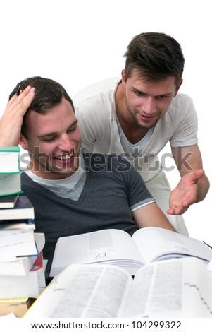 One man explaining the other homework - stock photo