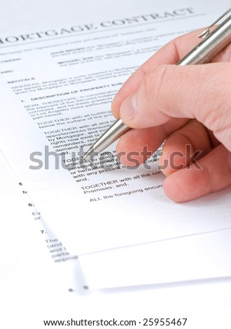 One man is examining mortgage contract for sale of real estate property - stock photo