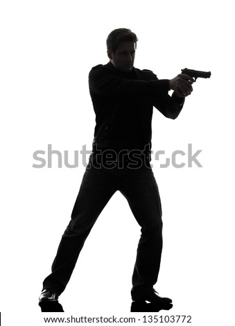 one man killer policeman aiming gun standing silhouette studio white background