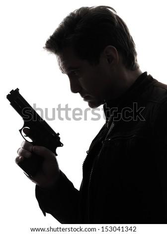 one man killer policeman holding gun portrait silhouette studio white background - stock photo