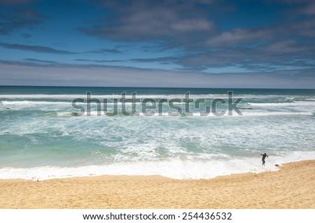 One man on the Beach Melbourne Victoria - stock photo