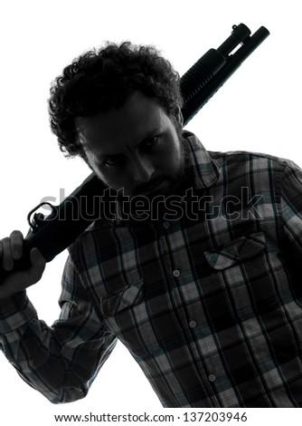 one man serial killer shotgun  silhouette studio isolated on white background - stock photo
