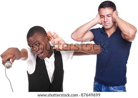one man singing and other man suffering from a headache - stock photo