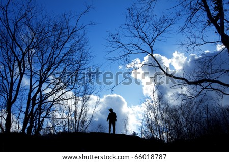 One man stand alone between dry trees - stock photo
