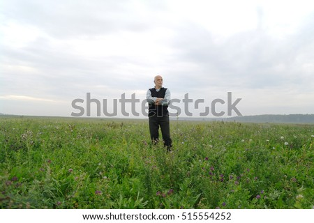 One man stands in the field and far forest