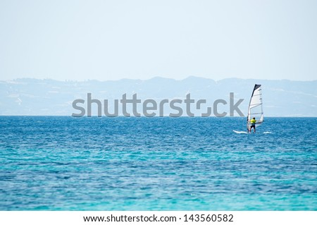 One man surfing on the big blue sea - stock photo