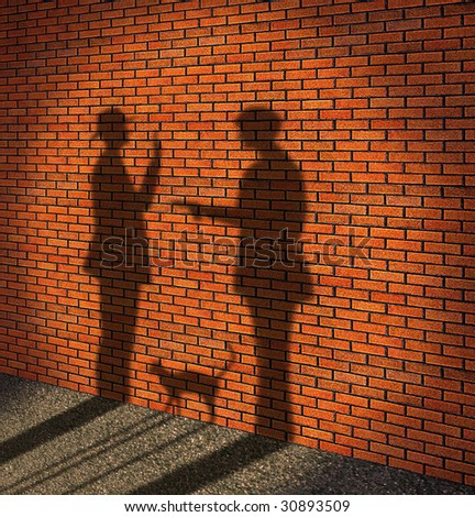 One man threatens with a pistol to other man. (It is made in the form of a shade on a brick wall)