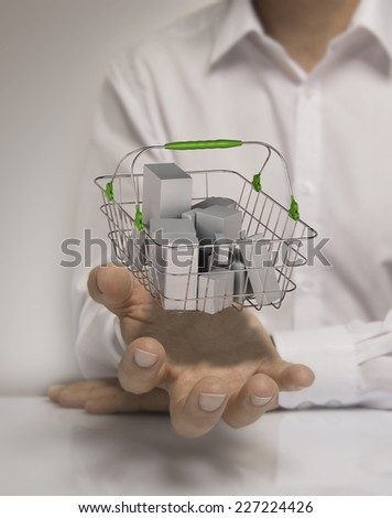 One man with basket containing generic goods at the top of open hand, concept of consumerism. - stock photo