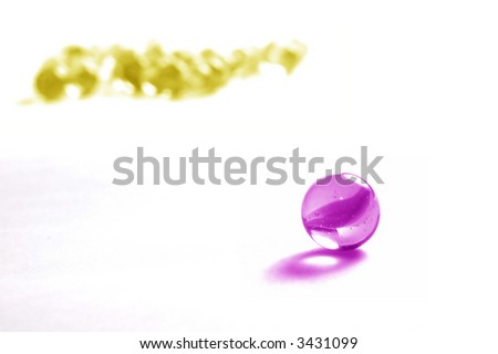 One marble againts others in different colour. - stock photo