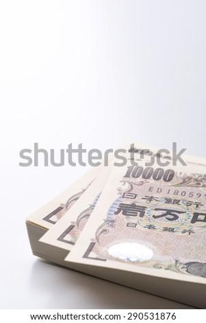 One million yen of wad on white background - stock photo
